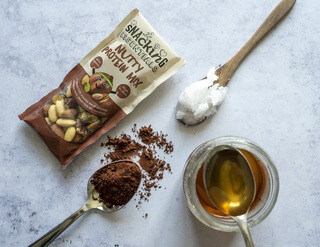 <p>Next make the homemade chocolate by mixing coconut oil, syrup and sweetener in a small saucepan over a low heat until completely melted. Don't boil it!</p>