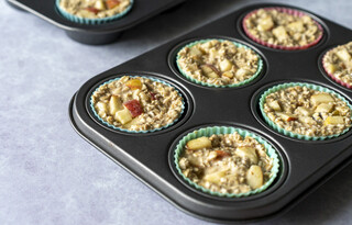 <p>Divide the mixture into 12 muffin cases and top each with remaining diced apples.<br />Pop in the oven for 30-35 minutes or until the middle of the muffin has set and a toothpick comes out clean.</p>
