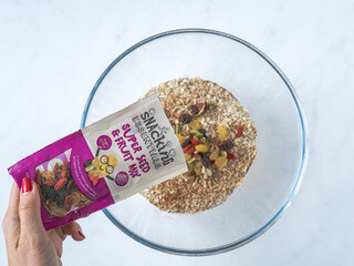 <p>In a large bowl mix oats with Snacking Essentials Super Seed and Fruit Mix, cinnamon, nutmeg, ginger, baking powder and salt.</p>