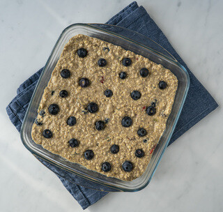 <p>In another smaller bowl mix mashed banana with almond milk, maple syrup and vanilla extract.</p><p>Pour the wet mixture into the dry mixture and combine thoroughly.</p>