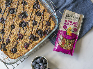 <p>Fold in the blueberries and pour the mixture into the prepared baking dish; top with more blueberries if desired.</p>